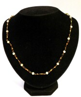 A cultured pearl and gold necklace, graduated design set with cultured pearls and twist design 9ct gold bars, yellow metal stamped 9ct, 52cm long, 8.9g all in.