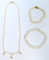 A group of pearl jewellery, comprising a single strand pearl necklace with three graduated pearl drop central section, on a yellow metal ball clasp stamped 14k, 41cm long, together with a cultured pearl bracelet, with 9ct gold clasp, 19cm long, and a mode