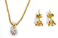 An 18ct gold diamond pendant and earring set, each set with a round brilliant cut diamond, in a six claw basket setting, the stones 5.8 x 5.8 x 2.8, approximately 0.62cts, the necklace on a rope twist chain, 42cm long, 7.7g all in, boxed.