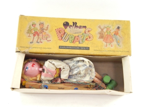 A mid 20thC Pelham puppet modelled as Gretel, of articulated form, partially painted, 30cm high. (boxed, af)