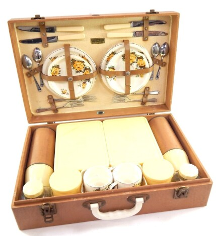 A mid 20thC Brexton picnic hamper, with plastic containers, part pottery service, in a fitted case, 49cm wide.