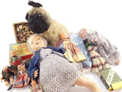 Various soft toys and effects, including a mid 20thC Petite doll, part clothed in a woollen outfit with sleep eyes, open mouth and articulated limbs, 44cm high, other doll's clothing, boxed word making and word taking games, other games, dolls, and an Arm