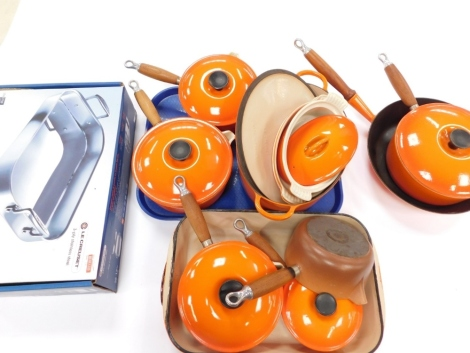 Various Le Creuset kitchen ware and pans, frying pan, 30cm diameter, other lidded pans, lidded tureen, open vegetable dish, and a stainless steel set, partially boxed. (a quantity)