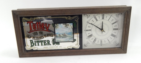 A modern Tetley Old Fashioned Flavoured Bitter advertising wall clock, of rectangular form with glazed front, Roman numeric dial, in moulded wooden case, battery powered, 55cm wide.