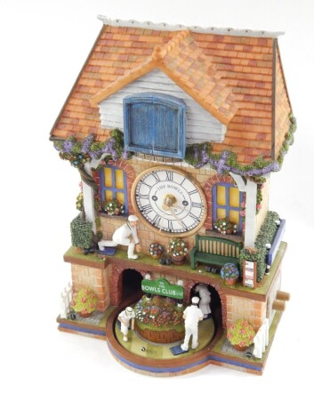 A Bradford Exchange The Spirit of Bowls resin free standing cuckoo clock, marked to the back, 33cm high.