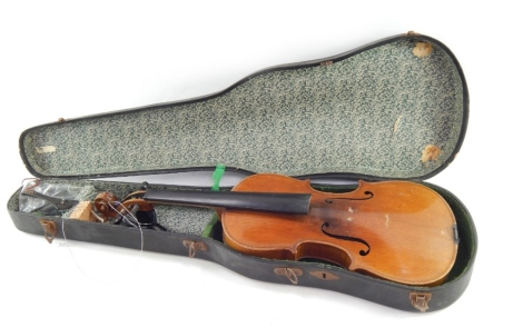 An early 20thC violin, with copy of Stradivarius, Berlin label, with two piece back, scroll end, ebonised knops and interior label, overall 59cm long. (cased, AF)