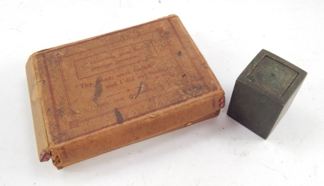 A bronze cased Eastern seal, in a block box with removable lid revealing a partially coloured seal, 5cm high, and a early 20thC box of precious religious style promises set with a quantity of paper promises, in a card outer packaging. (2)