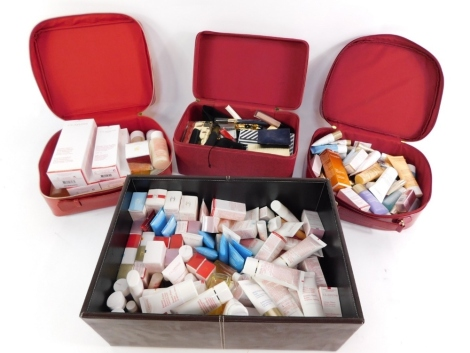 Various hair clips, Clarins Paris and others, vanity case, vinyl finish, 33cm wide, containing various other Clarins exfoliating cleanser, creams, make up, Lancome and other make up. (a quantity)