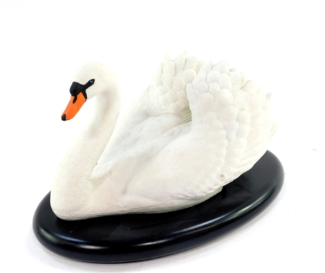 A Franklin Mint porcelain figure modelled as the Royal Swan, by Ronald Van Ruyckeveelt, printed marks, on an oval base.