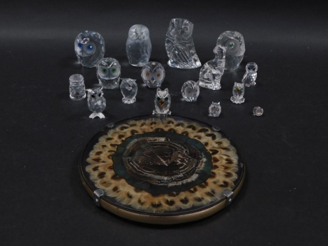 A group of Swarovski figures modelled as owls, a Tutbury Crystal owl and a Waterford crystal owl, together with roundel inset with feathers. (a quantity)