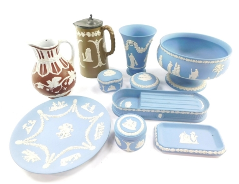 A group of Wedgwood light blue Jasper ware, including dressing table boxes and covers, pen tray, vase, plate and a fruit bowl, together with two Staffordshire late 19thC relief moulded jugs. (a quantity)