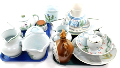A group of Buchan pottery, variously decorated, including a teapot, honey pot, cheese dish and cover, condiment set, jardinieres, jug and hors d'oeuvres dish. (a quantity)