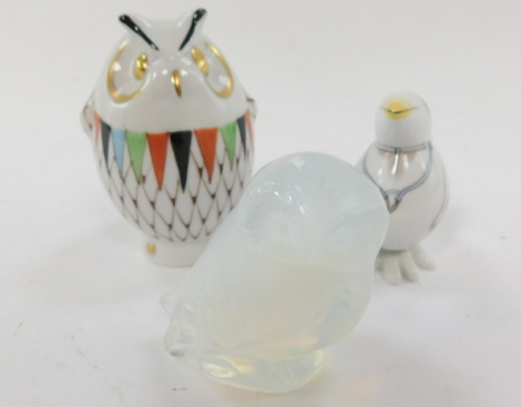 A Lalique opalescent glass figure of an owl, etched mark, together with a Meissen porcelain figure of a Doctor Bird, cross swords mark, and a Hollohaza porcelain figure of an owl. (3)