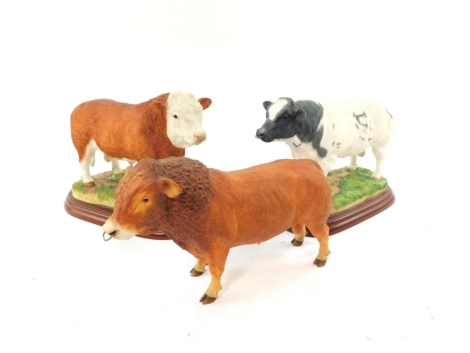 A Border Fine Arts figure modelled as a Belgian Blue Bull, Cattle County Show, A0744, together with a Simmental Bull, A0741, and a further bull. (3)