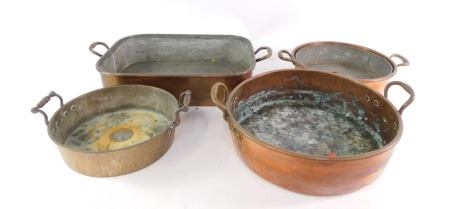 Various late 19th/early 20thC copper ware, fish kettle of oblong form with fixed handles, 56cm wide, and three circular skillets. (a quantity)