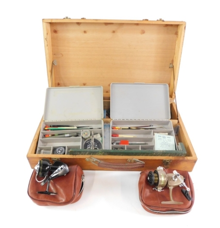 A rectangular pine fishing box, of cantilever form, containing a quantity of various fishing tackle, tackle box, floats, etc. the box 58cm wide.