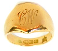 An 18ct gold signet ring, the central shield crest bearing the initials CW, Chester assay but dates rubbed, ring size G½, 6g.