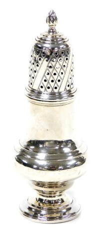 A George VI silver sugar shaker, with acorn finial top on baluster stem, on a stepped foot, Birmingham 1937, 3½oz, 16cm high.