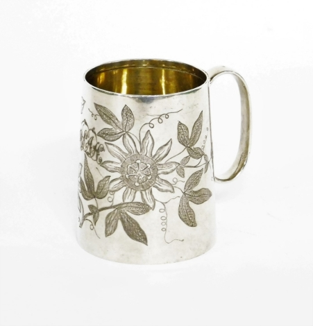 A Victorian silver child's tankard, heavily engine turned with flowers, bearing the initial WEAH, makers stamp JTH, London 1887, 6.5cm high, 3¼oz.
