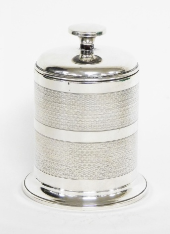 A George V silver cigarette dispenser case, with two row engine turned decoration, and glass interior, Birmingham 1923, 12cm high, 7½oz gross.