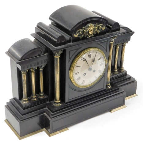 A late 19thC black slate mantel clock, with applied brass detailing on Corinthian column supports, on a stepped base, with eight day movement and pendulum, 37cm high, 50cm wide, 18cm deep.