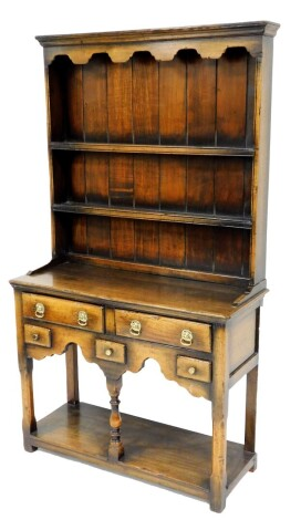 An oak dresser, in the 18thC style, with two plate shelf, the base with two long and three short drawers, above a pot board, 163cm high, 90cm wide, 36cm deep.