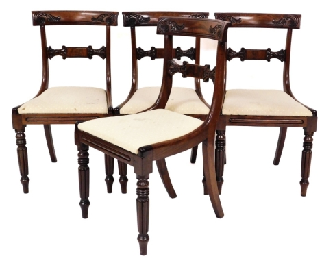 A set of four George IV mahogany dining chairs, each with curved and carved back and drop in cream upholstered seats, 87cm high.