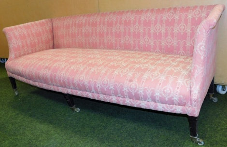 A Victorian upholstered three seater sofa, with a pink ribbon and urn design, on ebonised mahogany legs, 75cm high, 190cm wide, 72cm deep.