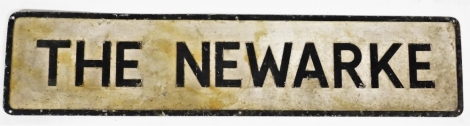 A black and white painted street sign, The Newarke, 23cm high, 101cm wide.