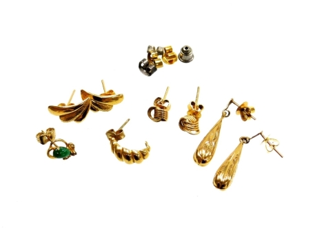 A group of 9ct gold and other earrings, to include a pair of 9ct gold drop earrings, a single hoop earring, fan design earrings, knot twist earrings, etc, some hallmarked 9ct, others unmarked and some silver, 7g all in.