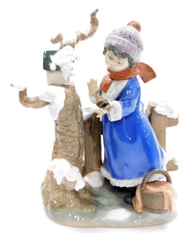 A large Lladro figure group, of a winter scene with young girl looking after birds, no. 5287, 28cm high.