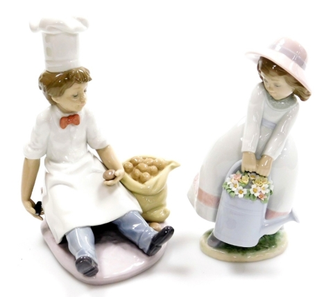 Two Lladro figures, to include a seated Chef no. 6233, 20cm high, and a girl carrying watering can with flowers no. 6876, 20cm high. (2)