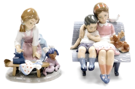 Two Lladro figure groups, to include a lady ironing with child no. 5782, 17cm high, and a figure of a girl and boy sat on bench with dog, with dove, 18cm high. (2)