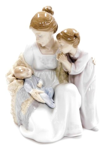 A Lladro figure group, of mother holding baby with child, no. 6939, 23cm high.