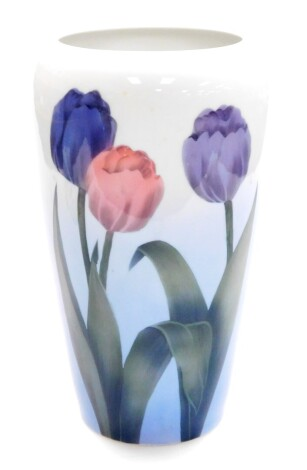 A Bing & Grondahl porcelain vase, decorated with two purple and one pink tulip, with B & G mark to underside and numbered 440-5450 AK, 28cm high.