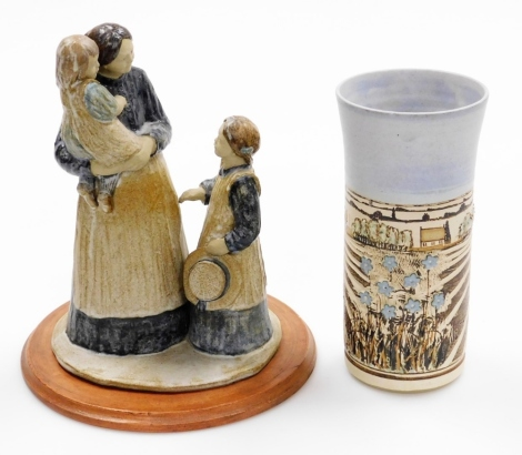 Two items of studio pottery, to include a studio pottery stem vase, signed Gough, and dated 95, of Fenland scene, with flowers, on a ribbed and flared body, 22cm high, together with a stoneware sculpture of lady carrying child talking to another figure, 2