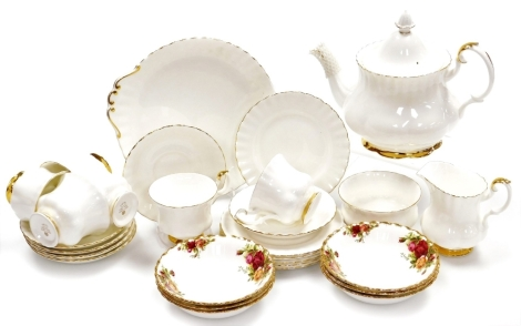 A Royal Albert Val D'or pattern part tea service, comprising teapot, six cups and saucers, six side plates, milk jug and sugar bowl, together with six Royal Albert Old Country Roses bowls. (1 tray)