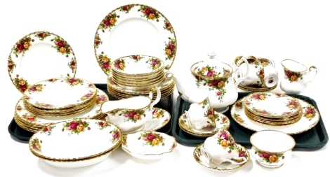 A Royal Albert Royal Country Roses part tea and dinner service, comprising gravy boat and saucer, soup bowls, side bowl, serving bowls, dinner plates, side plates, bread plates, six cups and saucers, teapot, milk jug, sugar bowl. (2 trays)