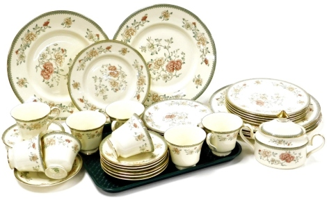 A Minton Jasmine pattern part tea and dinner service, comprising eight cups and saucers, eight side plates, tureen and cover, six bread plates and six dinner plates.