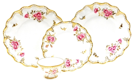 A group of Royal Crown Derby Royal Pinxton Rose pattern wares, to include a pair of large wall plates, with red stamp to underside, 25cm wide, a smaller plate stamped XL1 in red, 20cm wide, and a sugar bowl stamped XXVII. (4)