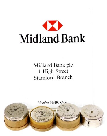 HSBC interest. The Midland Bank Stamford Branch sign, enamelled metal, and four Midland Bank Limited savings tins. (5)