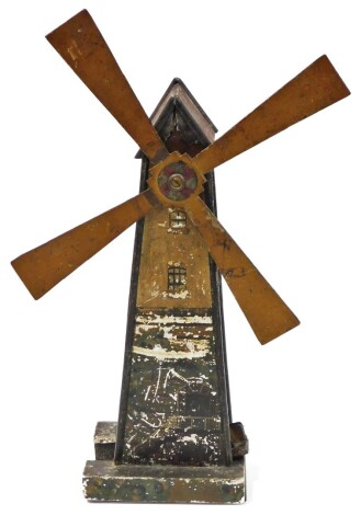 A late 19thC tin plate windmill, 43cm high.