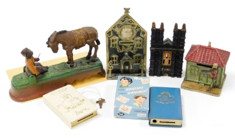 A group of novelty and other money boxes, to include a Cathedral Bank, a bank with clock aperture, a donkey and boy scene, a piggy bank book From Saving Comes Having, novelty saving bank and a miniature house and figure bank. (6)