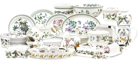 A group of Portmeirion Botanic garden part tea and dinner wares, comprising tureens, meat plates, side plates, napkins, butter dish and cover, milk jugs, coffee pot, vase, toast rack, pepper pot, vinaigrettes, etc. (a quantity)