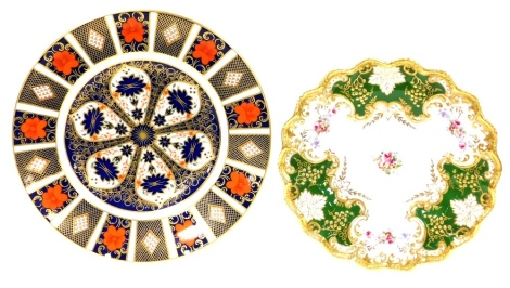 Two Royal Crown Derby Plates, to include a Royal Crown Derby Imari pattern plate numbered 1128, and a Royal Crown Derby green gilt and floral posies pattern plate. (2)
