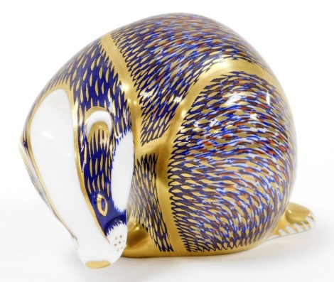 A Royal Crown Derby badger paperweight, with gold stopper, numbered III, 8cm high.