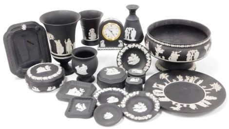A group of Wedgwood black Jasperware ceramics, to include trinket dishes, bud vases, clock, rose bowl, etc. (1 tray)