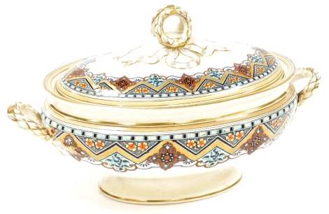 An early 20thC Royal Doulton tureen and cover, heavily decorated with flowers with blue and gilt banding, and knot tie handle, 21cm high, 39cm wide.