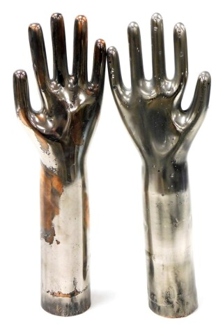 A set of silvered metal hand displays, possibly glove formers, 37cm high.