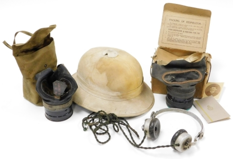 A group of military items, to include Erikson Beeston Notts, BBC a set of headphones, a cased gas mask and an explorers hat. (3)